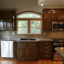 Remodeled kitchen cabinets by Artisan Construction, 7321 N Antioch Gladstone, MO 64119