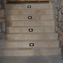 Outdoor lighting in steps by Artisan Construction, 7321 N Antioch Gladstone, MO  64119