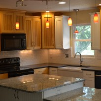 Kitchen lighting by General Contractors at Artisan Construction, 7321 N Antioch Gladstone, MO 64119 can expertly add lighting to any room in your home.