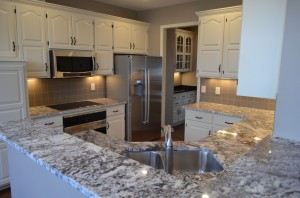 Kitchen Cabinets refaced, replaced or repainted by Artisan Construction, 7321 N Antioch Gladstone, MO  64119