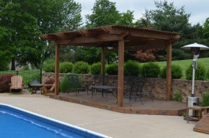 Custom designed pergola by Artisan Construction, 7321 N Antioch Gladstone, MO  64119. Add interest to your outdoor space with a custom designed pergola.