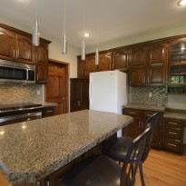 Remodeled kitchen cabinets are painted for updated look by Artisan Construction, 7321 N Antioch Gladstone, MO 64119