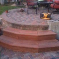 Custom built patio with stone work and wood work by Artisan Construction, 7321 N Antioch Gladstone, MO  64119