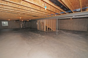 "img src=""https://kcartisanconstruction.com /images/unfinihed-basement.jpg""  alt=""Artisan Construction, Gladstone, MO"""