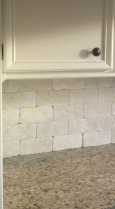 Choose a tile backsplash for your kitchen in stone or tumbled stone. The look of your backsplach will be elegant and statement worthy. This backsplash was installed by Artisan Construction, Gladstone, MO